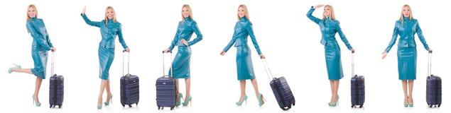 Kobiety narządzanie dla wakacje z walizką na bielu Zdjęcie Royalty Free