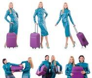 Kobiety narządzanie dla wakacje z walizką na bielu Obrazy Stock