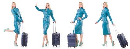 Kobiety narządzanie dla wakacje z walizką na bielu Obraz Royalty Free