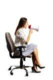 Kobiety obsiadanie na krześle nad bielem Obraz Royalty Free