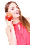 Kobiety powabnej dziewczyny kolorowy makeup trzyma jabłczaną owoc Obrazy Royalty Free