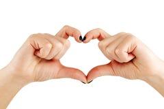 kobiety ręk hearth robi kształta potomstwom zdjęcie stock