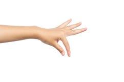 Kobiety ręka - podnosi up przedmiot odizolowywającego na białym tle obraz royalty free