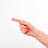 Kobiety ręka pokazywać kierunek Obrazy Royalty Free