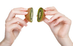 Kobiety ręka z kiwi owoc odizolowywającą Fotografia Stock