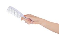 Kobiety ręki mienia włosy grępla Fotografia Stock