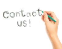 Kobiety ręki writing kontakt my na bielu zdjęcia royalty free