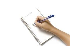 Kobiety ręki writing z piórem na notatniku Zdjęcie Stock