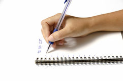 Kobiety ręki writing z piórem na notatniku Zdjęcia Stock
