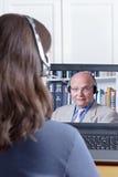 Kobiety słuchawki wideo wezwania nauczyciel obrazy stock