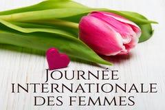 Kobiety ` s dnia karta z francuzem formułuje ` Journée Internationale des femmes ` obraz stock