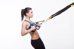 Kobiety szkolenie z zawieszenie trenera temblakiem Obrazy Royalty Free