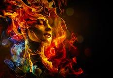Kobiety twarz robić z ogieniem Zdjęcie Royalty Free