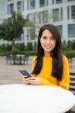 Kobiety use telefon komórkowy Zdjęcie Royalty Free