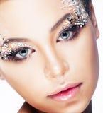 Kobiety wakacyjna twarz - jaskrawy uzupełniający Fotografia Royalty Free