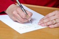 Kobiety writing Obrazy Royalty Free