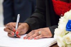 Kobiety writing w książce Fotografia Royalty Free