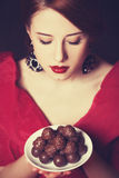 Kobiety z cukierkiem. Obrazy Stock