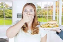Kobiety zamknięty usta dla szybkiego żarcia Obrazy Royalty Free