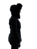 Kobiety zimy żakieta pozyci profilu sylwetka obraz stock