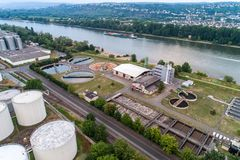 Koblenz GERMANY 21.07.2018 Aerial view of modern industrial sewage treatment plant beside the rhine river royalty free stock photos