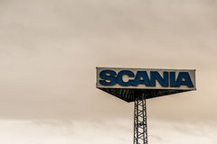 Koblenz, Germany, 20.02.2017 : Sign tower Scania trucks Logo against cloudy sky sunset at german service headquater Stock Photography