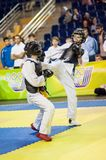 Kobudo competition between boys Royalty Free Stock Images