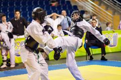 Kobudo competition between boys Royalty Free Stock Image
