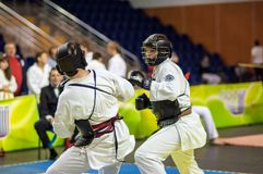Kobudo competition between boys. Royalty Free Stock Images