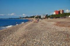 Kobuleti beach Georgia. Pebbles, some people, sunny day, end of the season, September autumn royalty free stock photo
