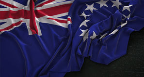 Koch Islands Flag Wrinkled auf dunklem Hintergrund 3D übertragen Lizenzfreie Stockbilder