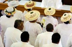 Koch-Islands-Leute beten bei CICC Kirche Stockfotos