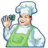 Koch mit einem Petersiliezweig Stockbilder