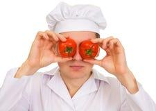 Koch mit roter Tomate Stockbilder