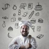 Koch mit seinen dreemfoods stockfotos