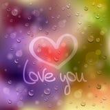 Kocha ciebie. Patroszony serce na mokrym szkle Zdjęcie Stock