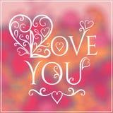 Kocha Ciebie tekst na Zamazanym tle z kwiecistym Obraz Royalty Free