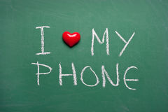 Kocham mój telefon Fotografia Royalty Free