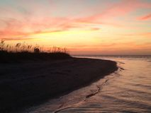 Kochanka klucza plaży zmierzch obraz royalty free