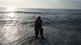 Kochankowie przy plażą Fotografia Stock