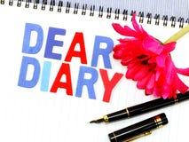Kochany dzienniczka słowo na białego papieru notatniku obrazy stock