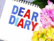 Kochany dzienniczka słowo na białego papieru notatniku zdjęcie royalty free