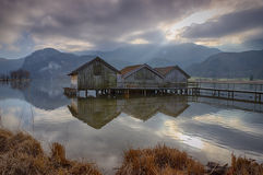 Kochel lake with huts. In Bavaria, the Alps in background royalty free stock photos