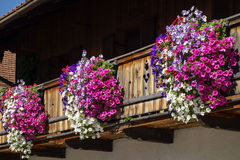 Balcony flowers on a house in Kochel, Bavaria. Kochel am See, Kochelsee, Balcony Flowers at a Farmhouse, Bavaria, Upper Bavaria, Germany, Europe Stock Photography