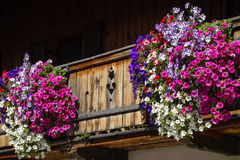 Balcony flowers on a house in Kochel, Bavaria. Kochel am See, Kochelsee, Balcony Flowers at a Farmhouse, Bavaria, Upper Bavaria, Germany, Europe Royalty Free Stock Photography