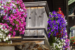 Balcony flowers on a house in Kochel, Bavaria. Kochel am See, Kochelsee, Balcony Flowers at a Farmhouse, Bavaria, Upper Bavaria, Germany, Europe Royalty Free Stock Photo