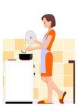 Kochen der Frau Stockfotografie
