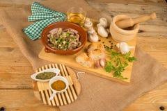 Kochen der Pilze Stockbilder