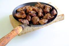 Kochen des Fleisches Lizenzfreie Stockfotos