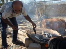Kochen von Fischen in Hengam-Insel, der Iran Lizenzfreie Stockbilder